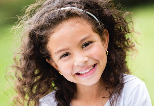 little girl smiling at camera