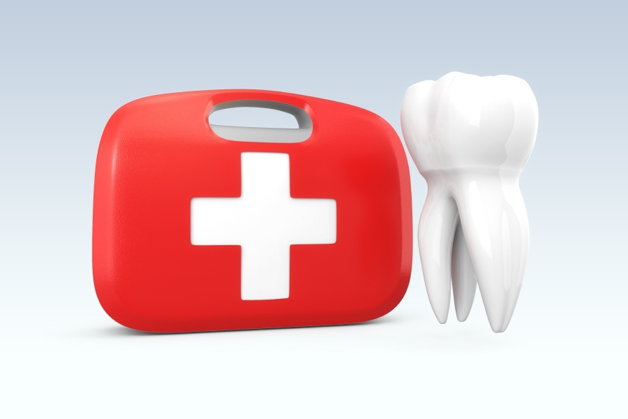 A red first aid kit next to a tooth graphic to indicate a childhood dental emergency